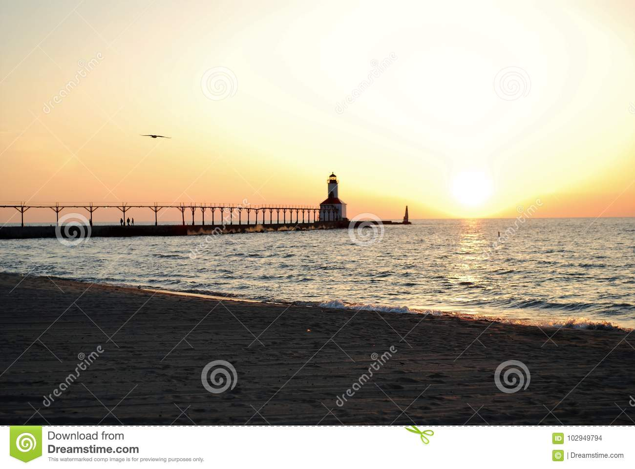 Summer sunset over the lighthouse on lake michigan in michigan city indiana