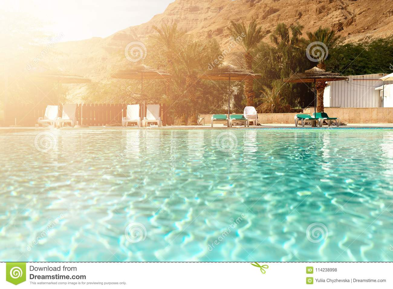 Outdoor Natural Gas Fire Pit Table, Summer Travel Vacation And Holiday Concept Lounge Chairs Near Swimming Pool Against Judean Desert Turquoise Pool Stock Photo Image Of Green Outdoors 114238998