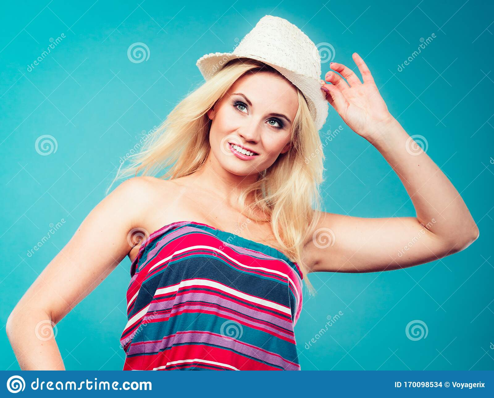 Blonde Woman Wearing Colorful Striped Strapless Shirt Stock Photo