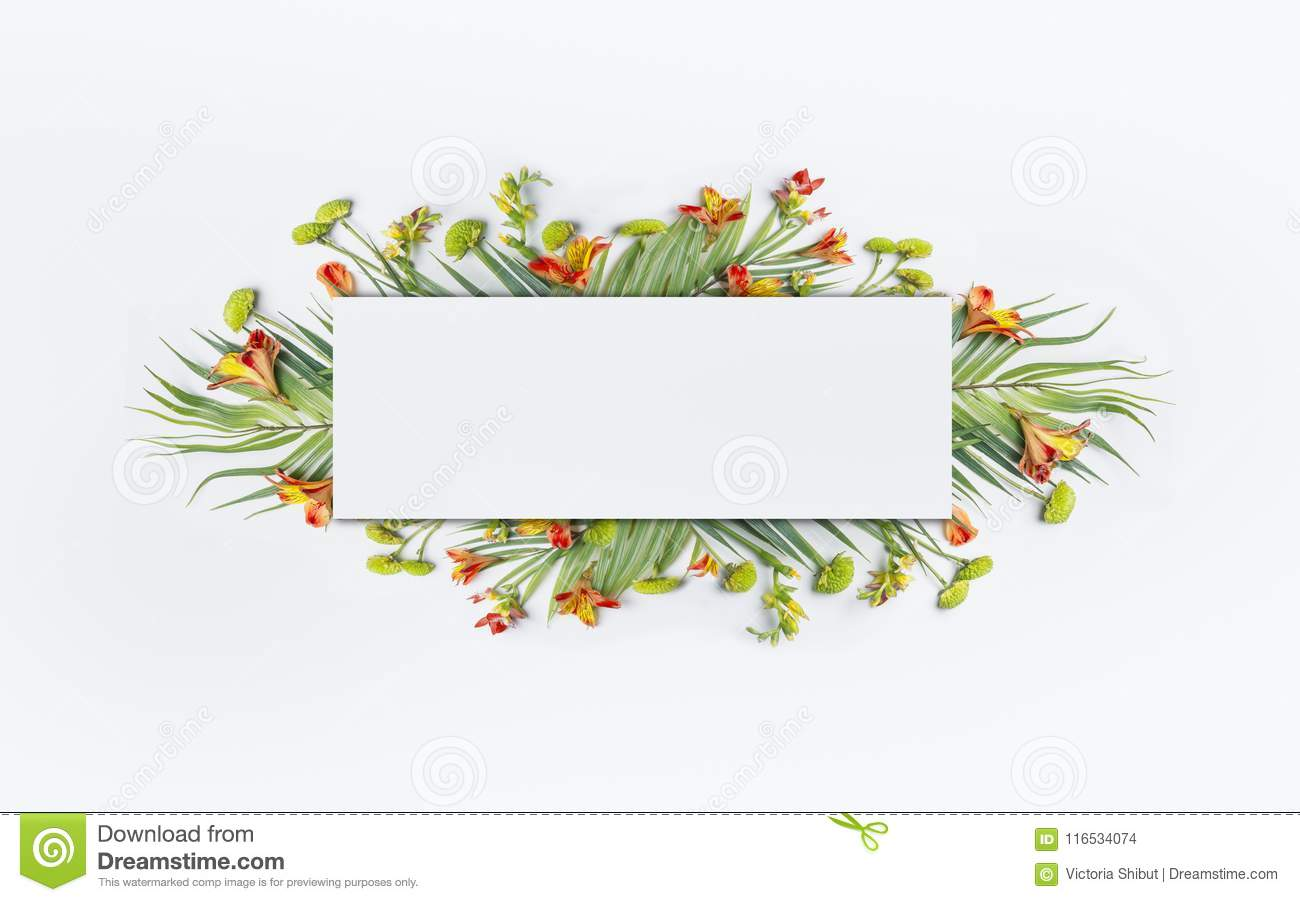 Summer tropical creative design with palm leaves and exotic flowers for banner or flyer on white