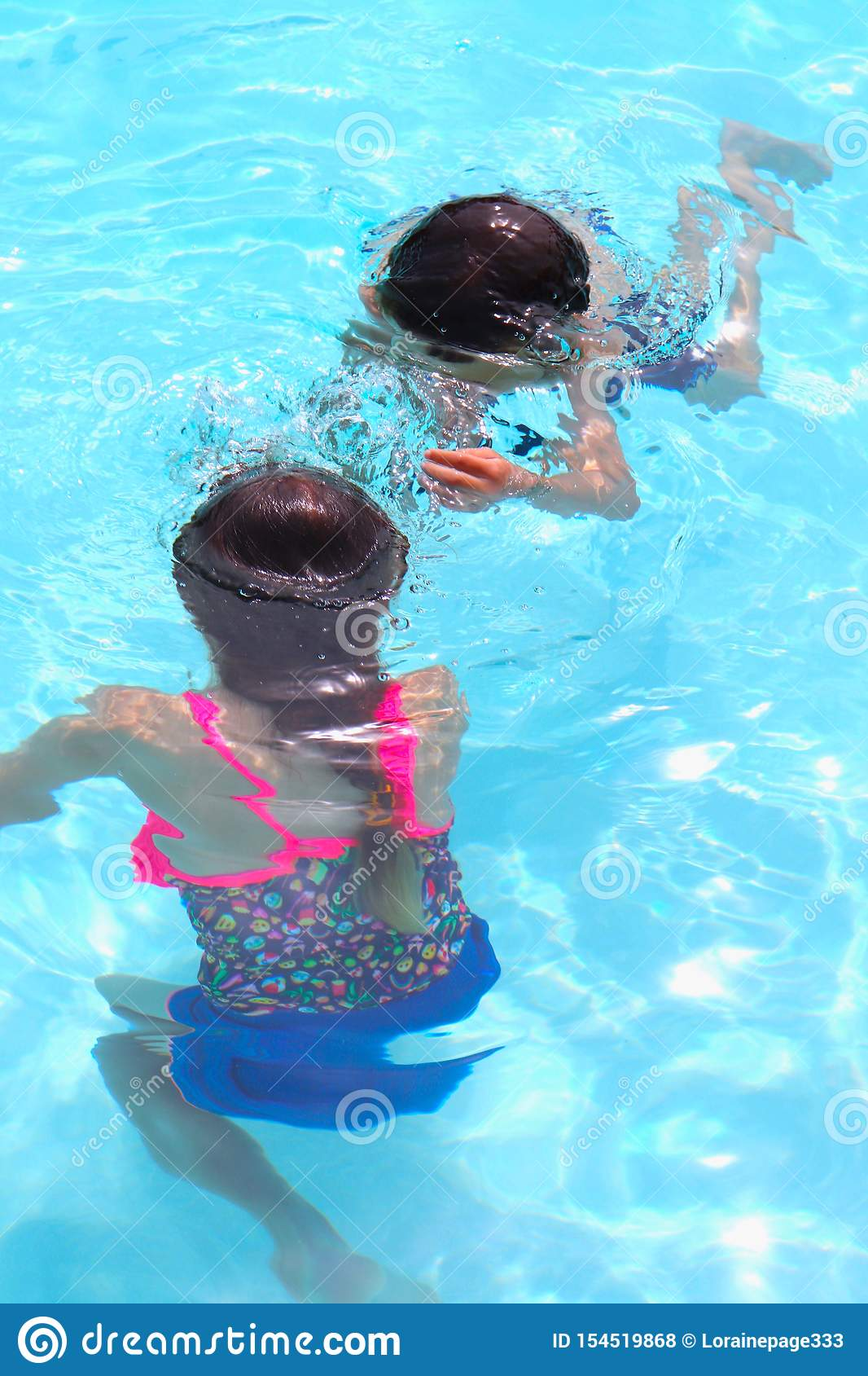 Pool Fun With Kids Playing Underwater During Summer Vacation