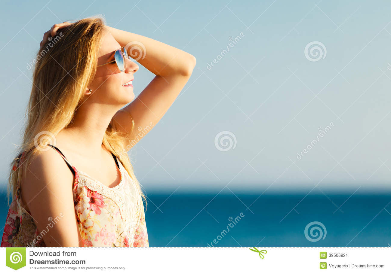Summer vacation. Girl standing alone on the beach.