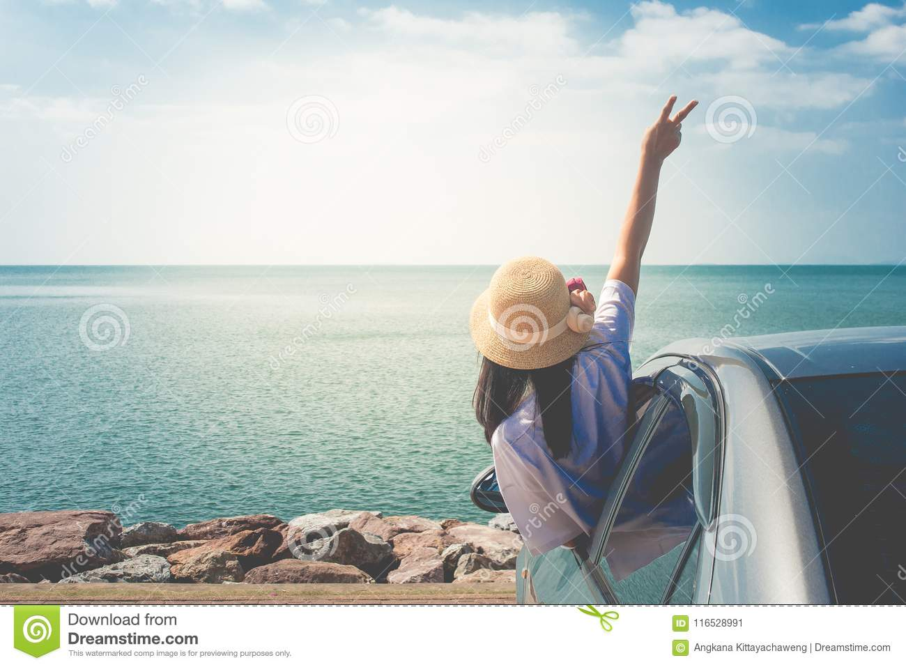 Summer Vacation and Holiday Concept : Happy family car trip at the sea, Portrait woman feeling happiness.