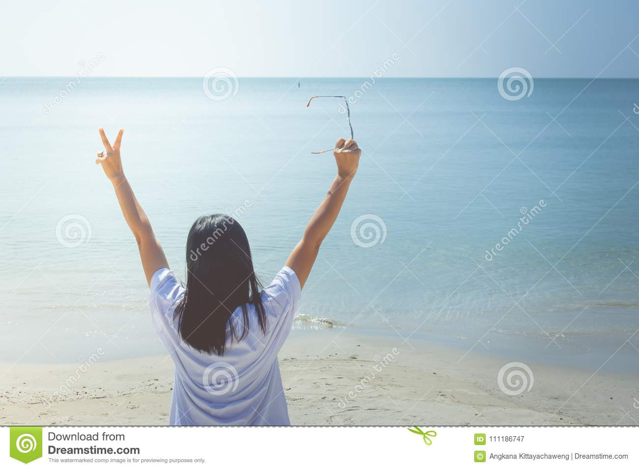 Summer Vacation and Holiday Concept : Happy family day trip at the sea, Woman standing relax on sand beach.