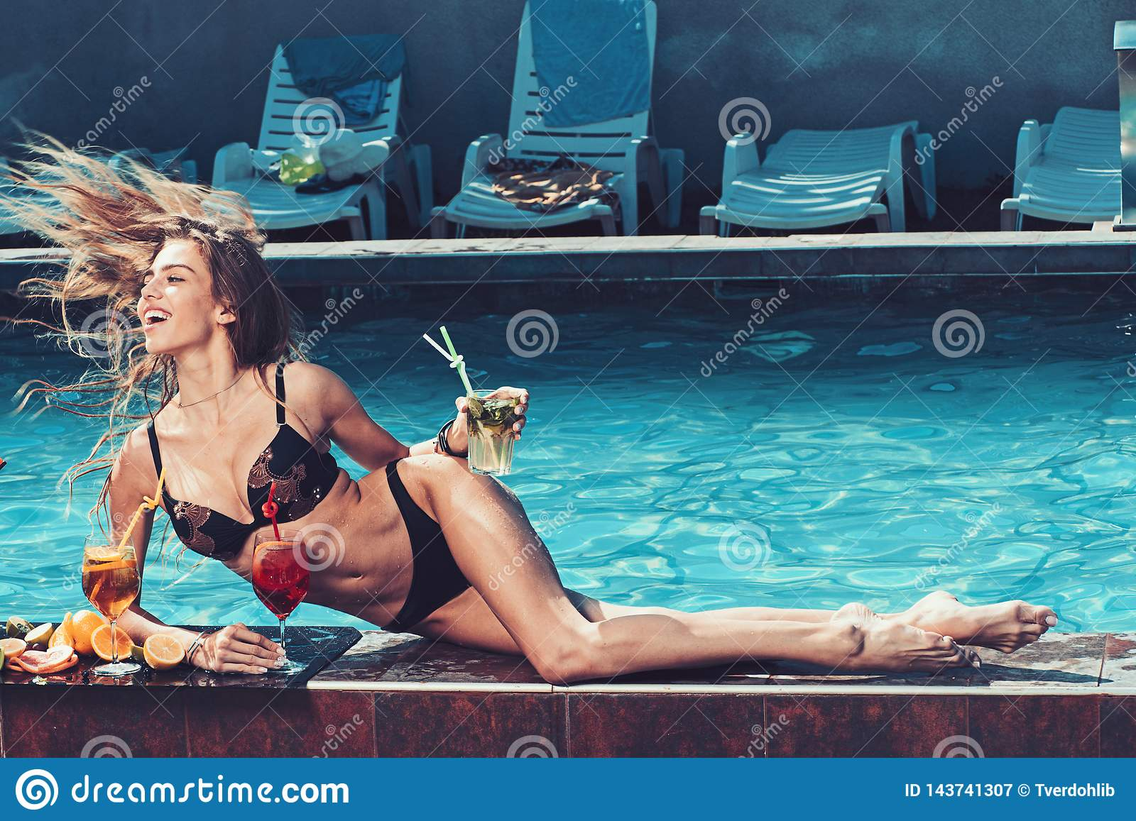 Summer vacation and swimming at sea. Pool party relax in spa resort. Fashion woman with refresh alcohol in miami