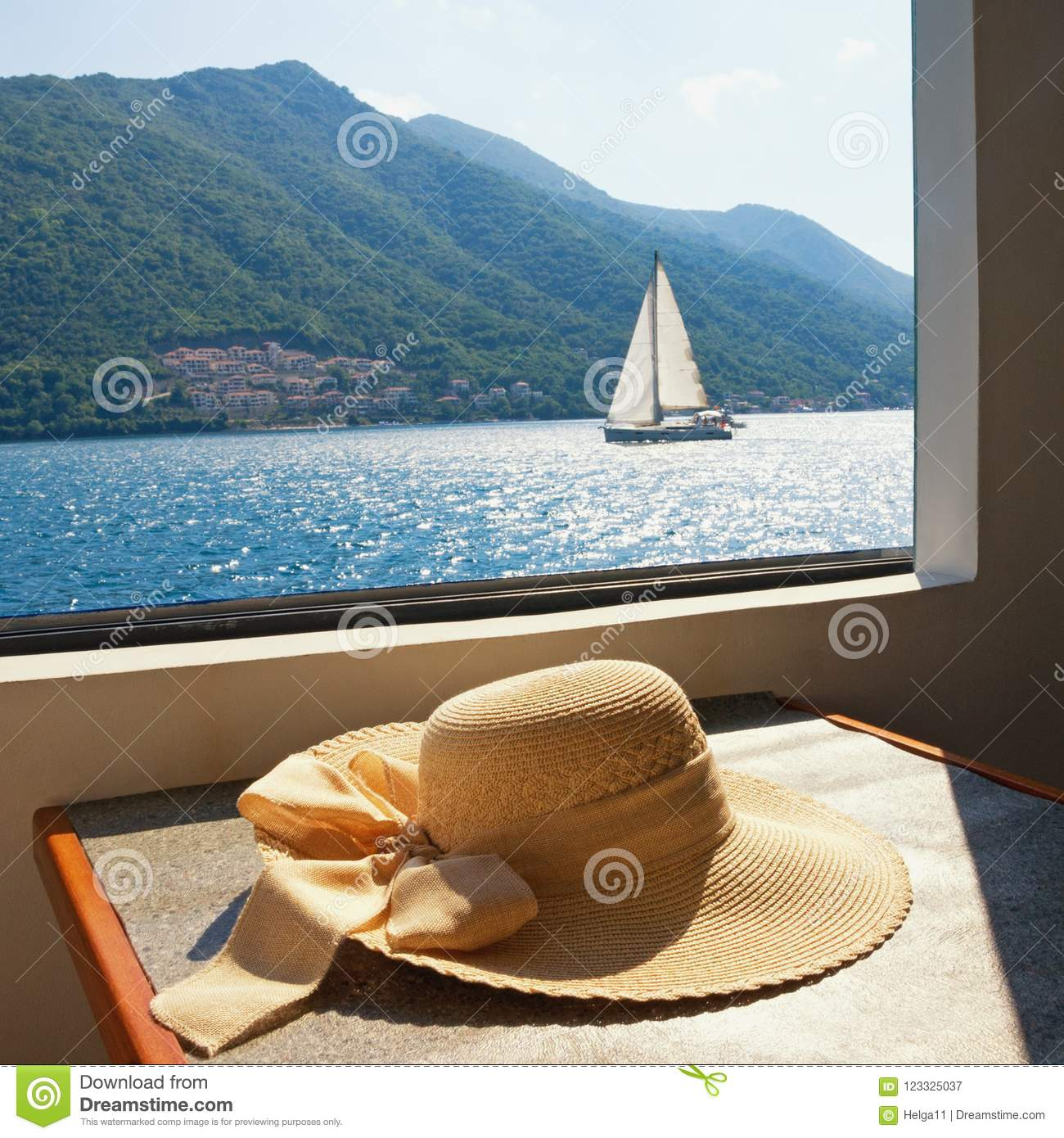 cb673ff0df5 Summer Vacation. Women`s Sun Hat On The Table Of Pleasure Ship Stock ...