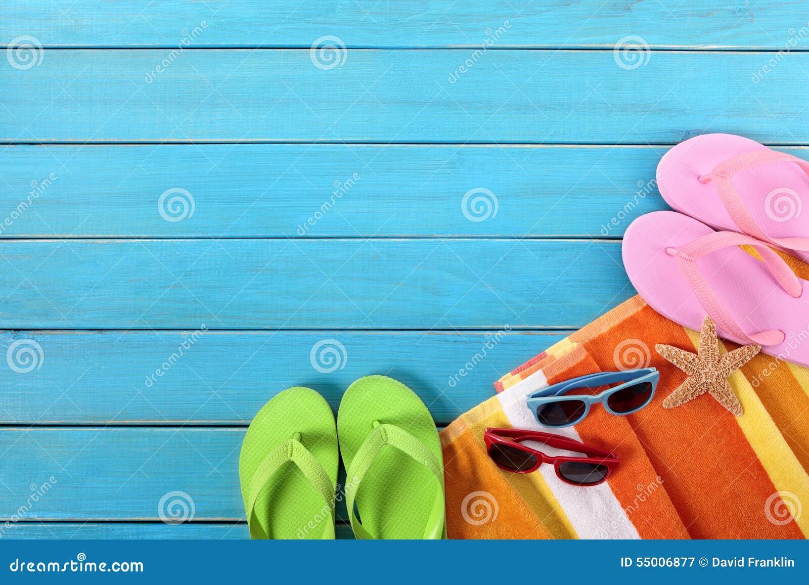 Summer vaction beach background, flip flops, sunglasses, copy space