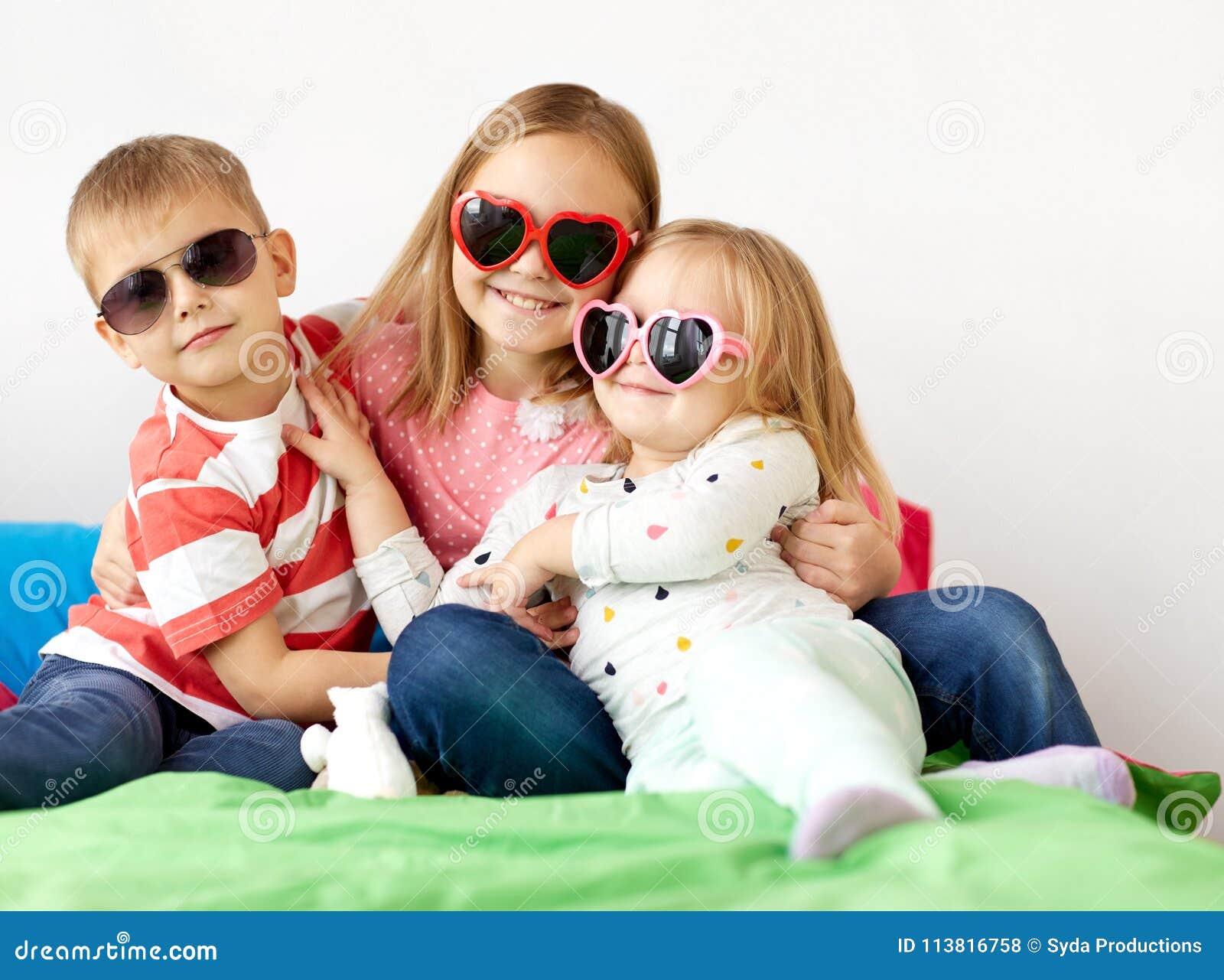 e24fcc52b8 Happy Little Kids In Sunglasses At Home Stock Photo - Image of ...