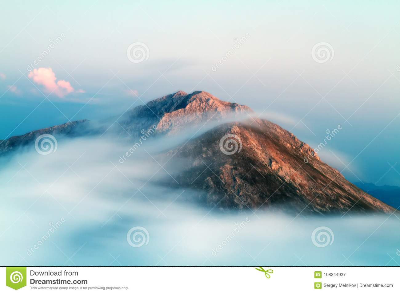 Formation and movement of clouds over mountains peaks.