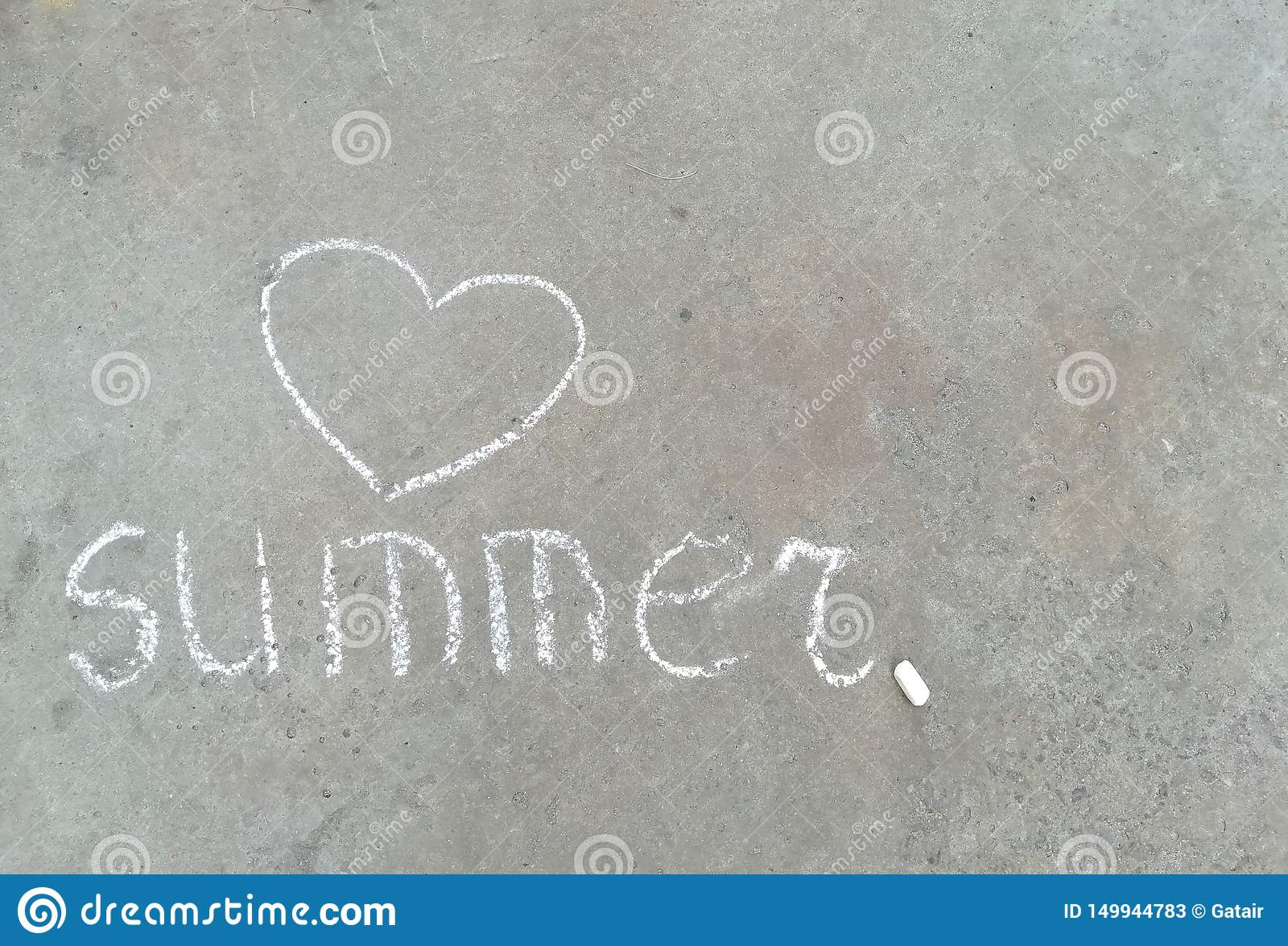 Summer word and heart - white chalk hand drawing on black asphalt