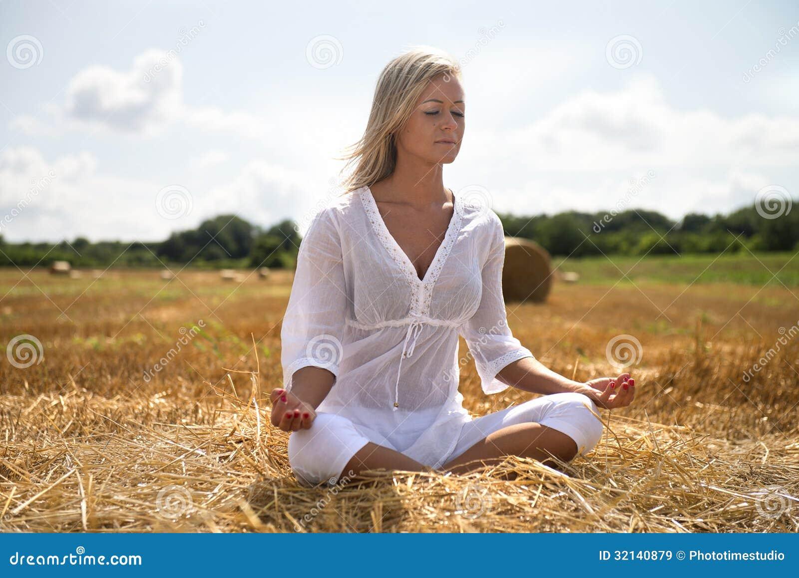 Summer yoga in meadow
