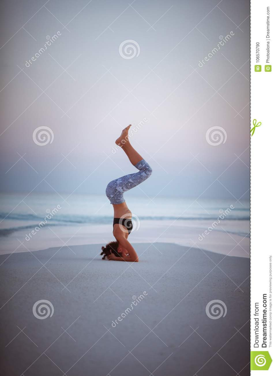 Summer yoga session on a beautiful golden beach of Maldives yoga tour, Salamba Sirsasana - supported headstand