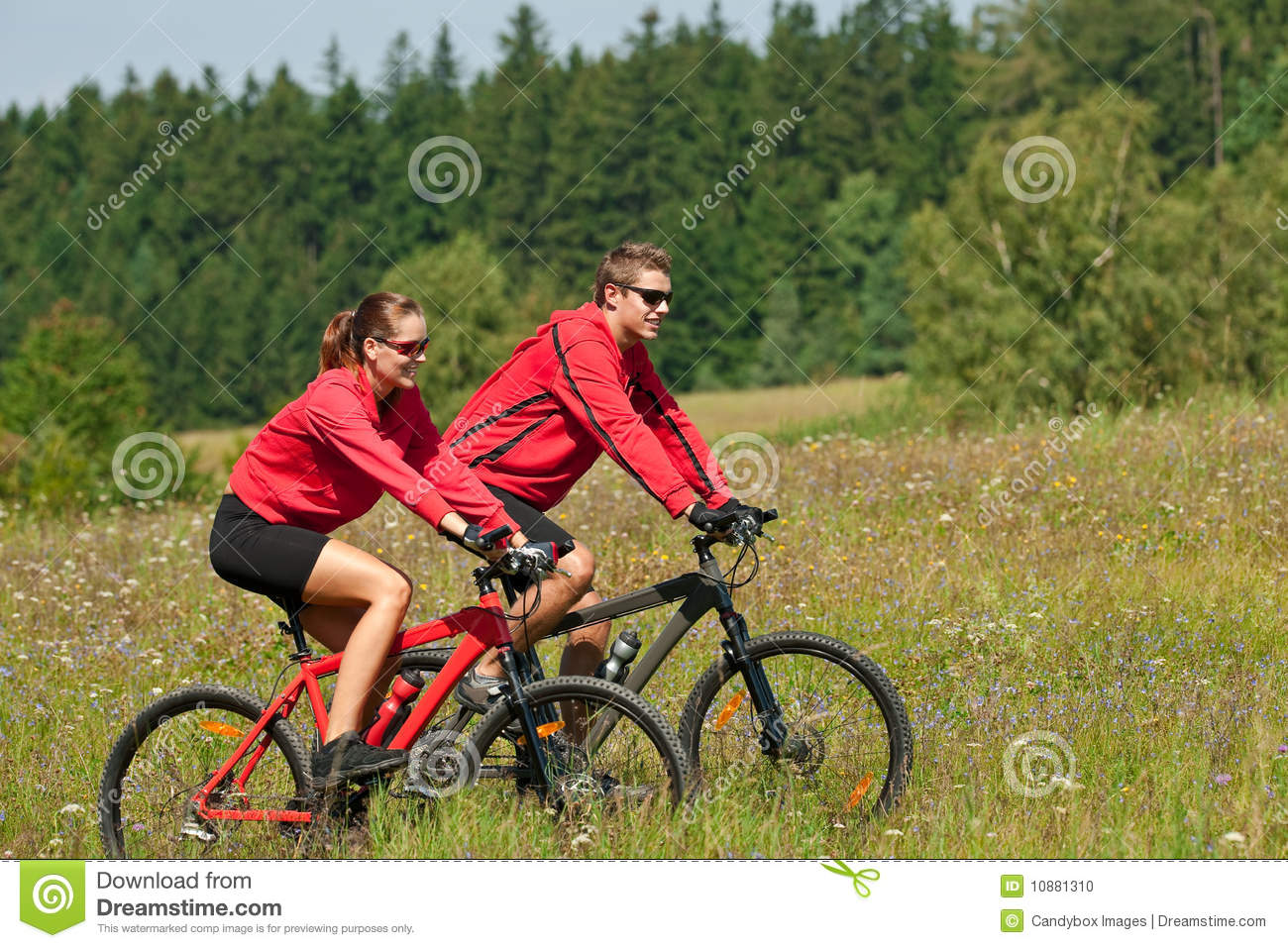 Summer - Young couple riding bike in summer
