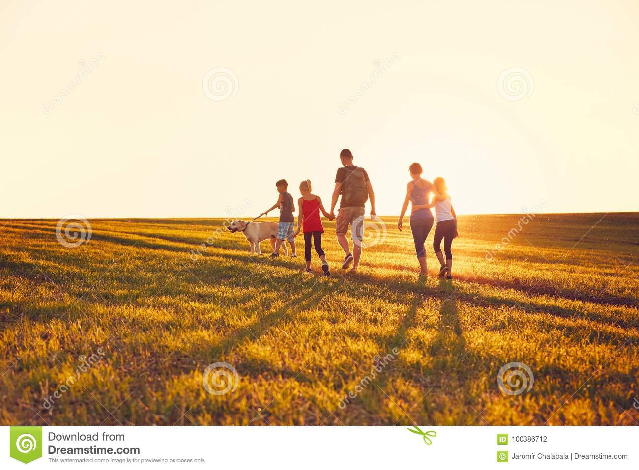 Download Family With Dog On The Trip Stock Photo - Image of meadow, activity: 100386712