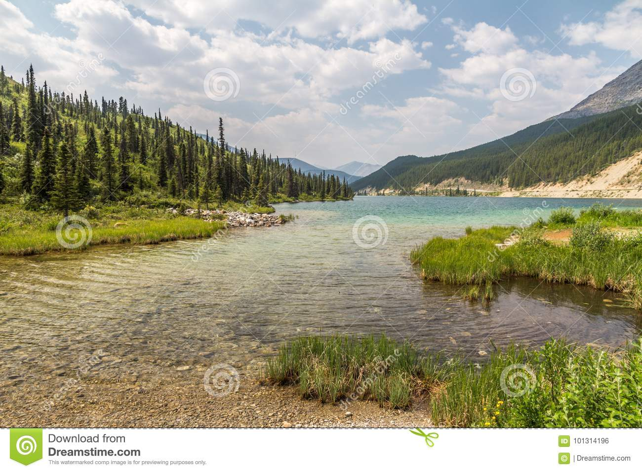 Clear, turqouise waters of Summit Lake, Northern Rocky Mountains, BC