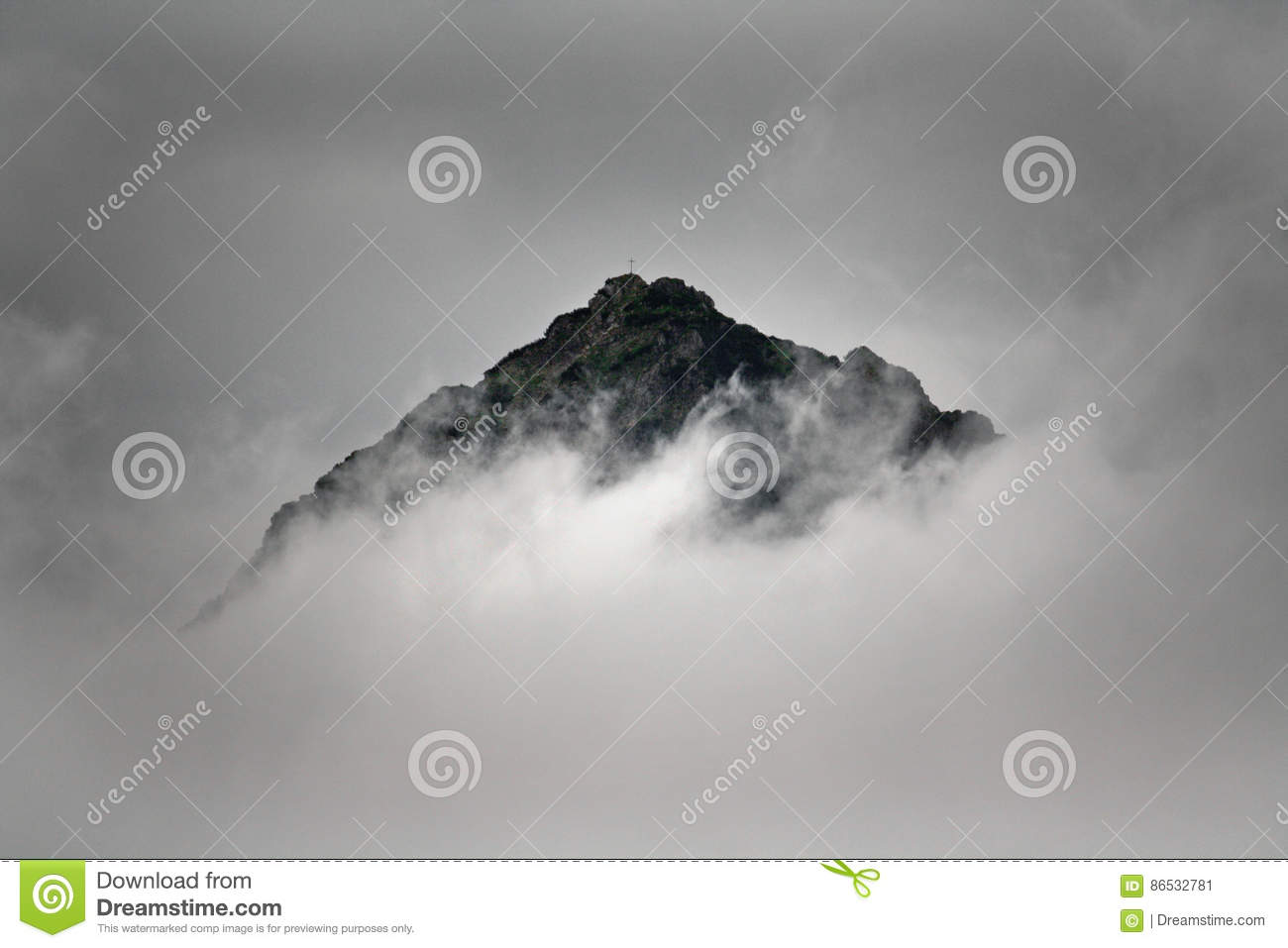 Summit of a mountain in the clouds