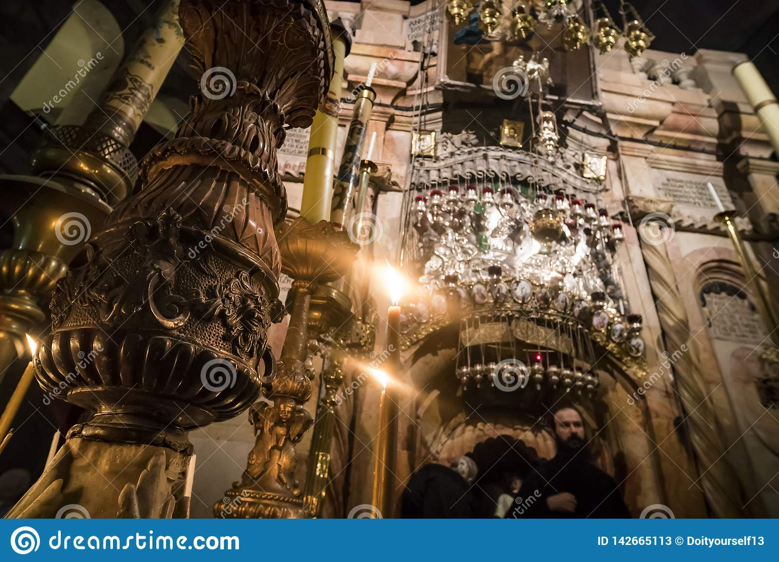 The sumptuousness interior and of burning candles of the Church of Holy Sepulchre, Jerusalem, Israel: October 24, 2018