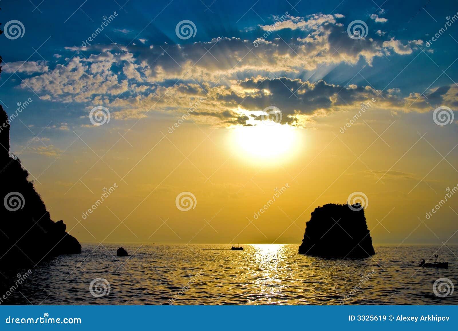 The sun above the sea