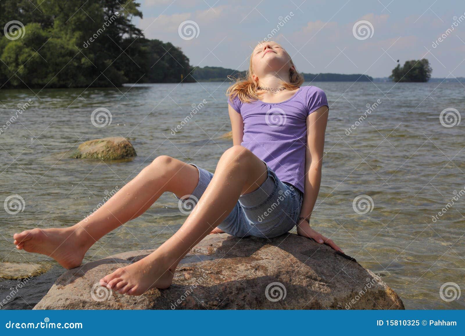 Sun bathing at the lake stock image. Image of enjoyment - 15810325 f0e1edccc92