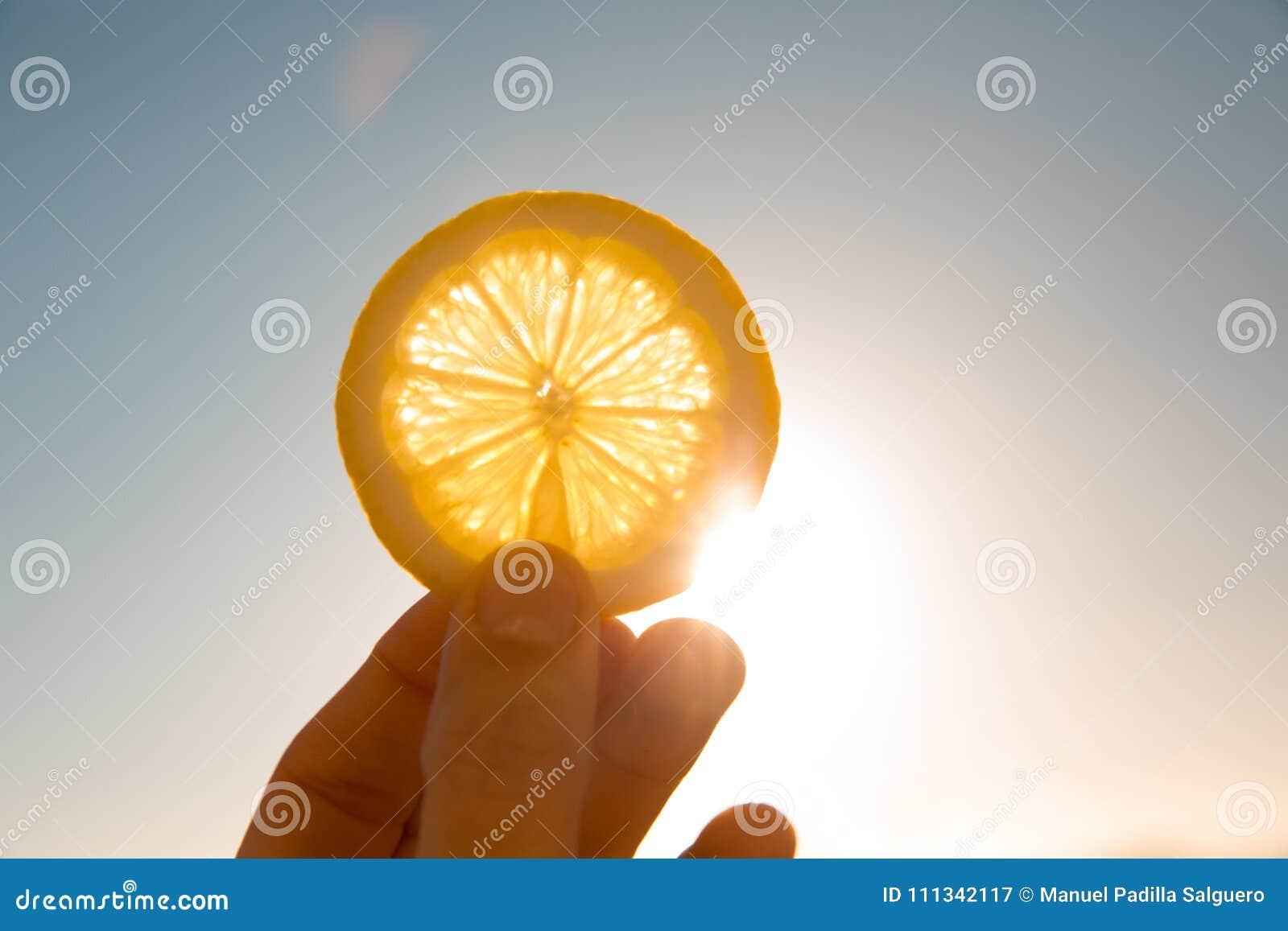 Sun behind lemon slice