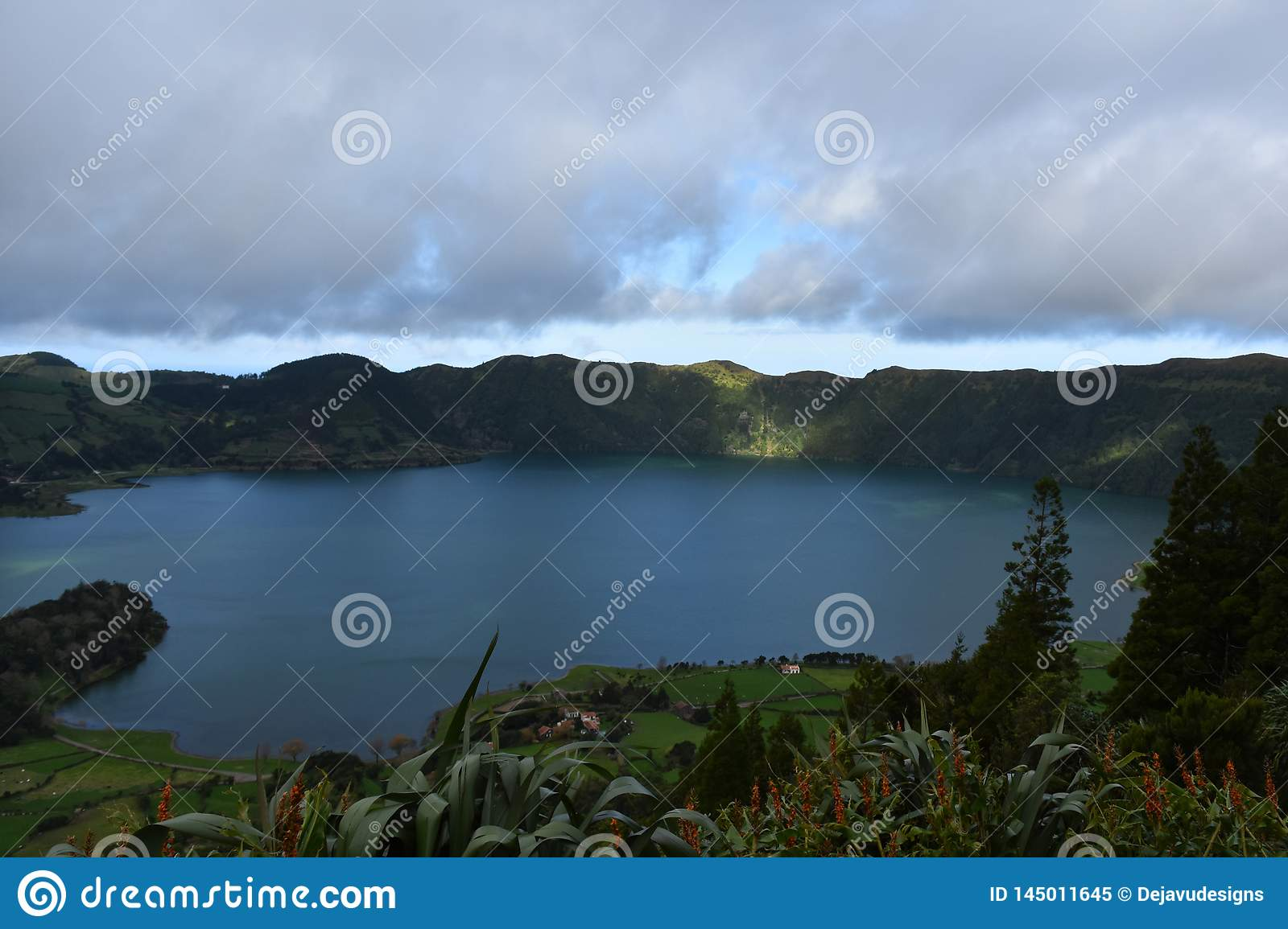 Sun Breaking Through the Clouds to a Blue Lake in the Azores