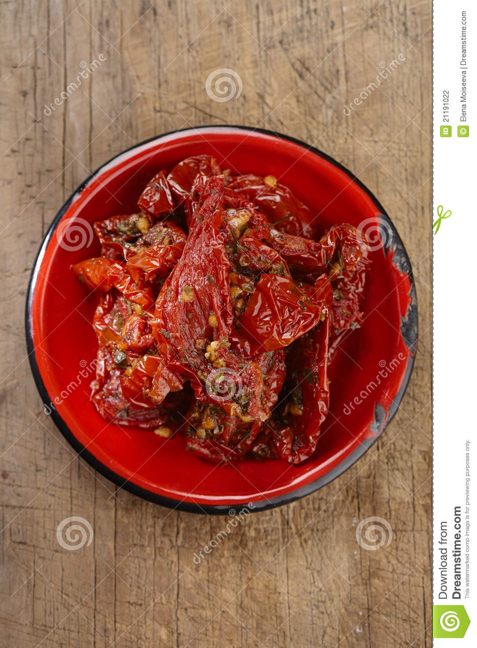 Sun-dried tomatoes with olive oil in red enamel