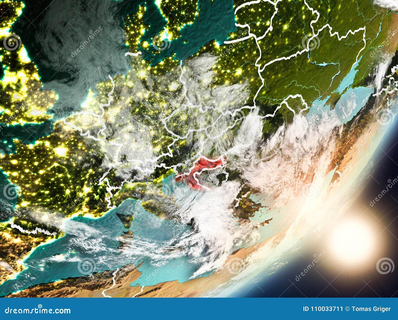 Sun que sube sobre Croacia del espacio