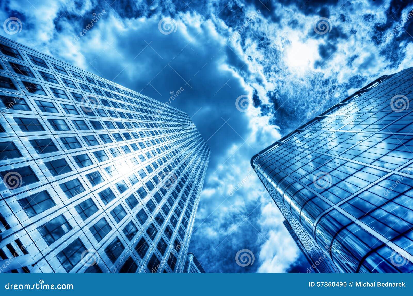 Sun reflecting in modern business skyscraper, high-rise building