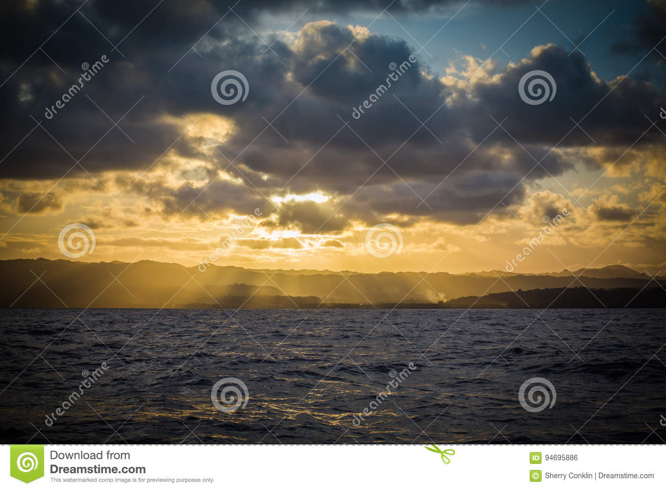 Sun Set over island mountains from the ocean