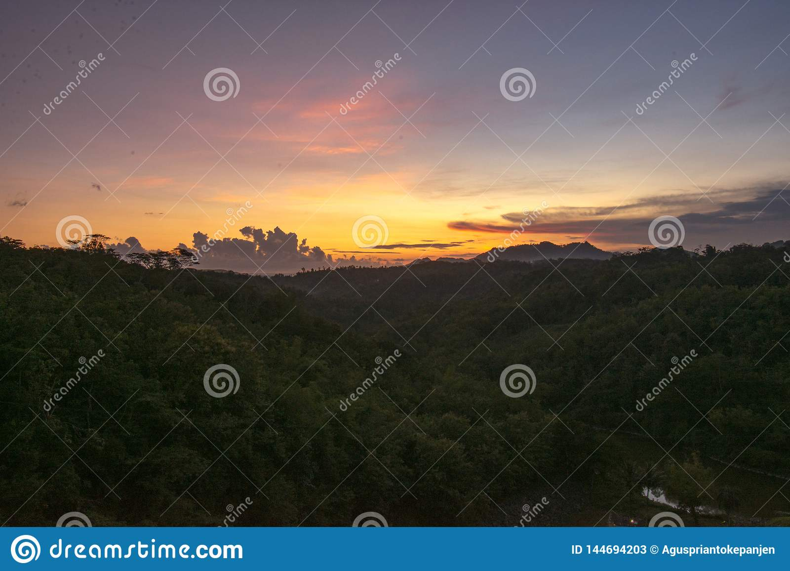 The sun sets over the hills