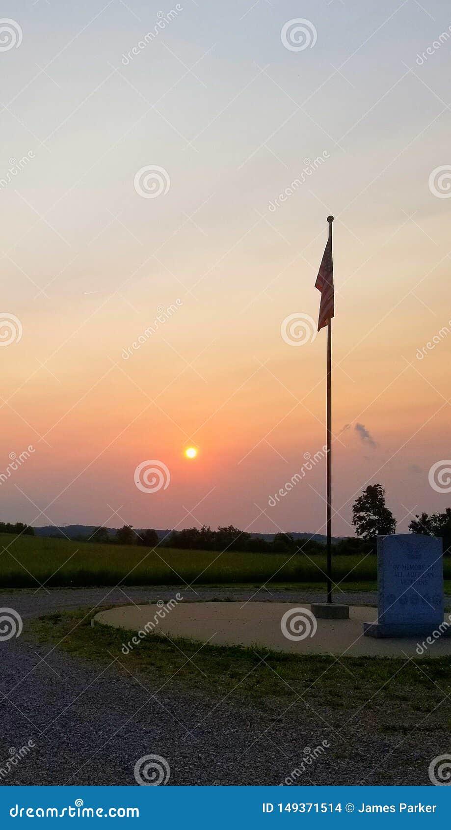 Sun setting on the flag pole