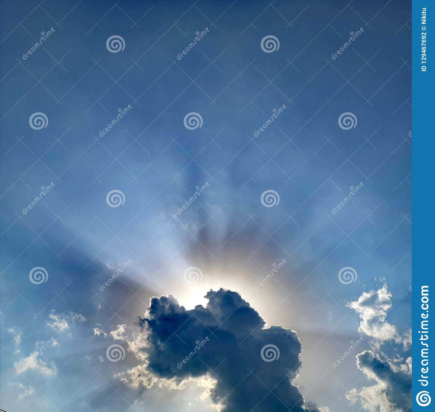 Sun shining with divine light from cloud