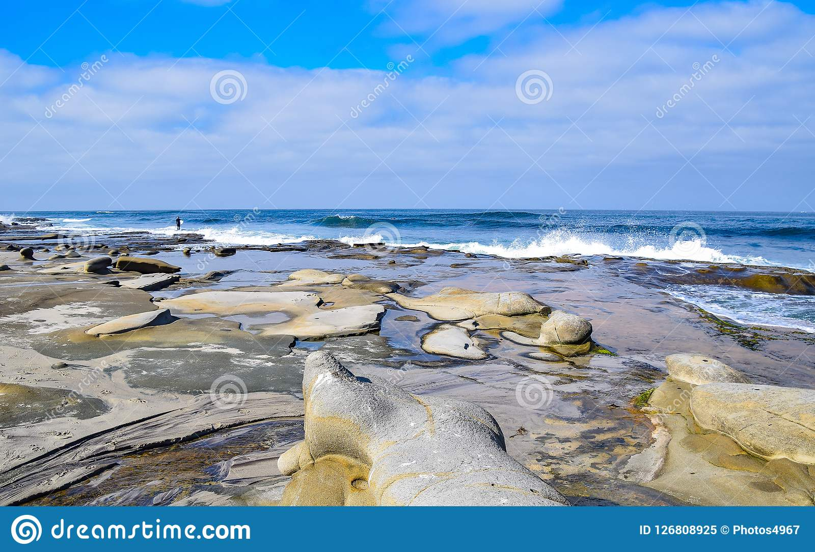 Sun, Surf, and Sculptured Cliffs. There are fascinating natural rock sculptures along the coast of La Jolla, CA Royalty Free Stock Photo