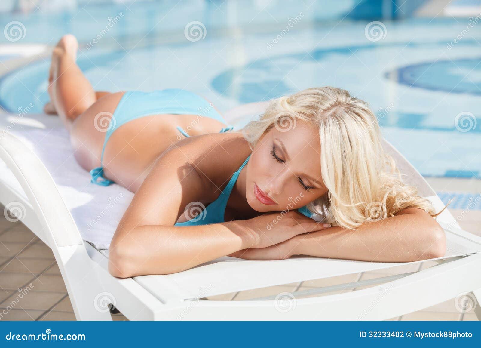 Sun Tanning. Beautiful Young Women In Bikini Lying On The ...