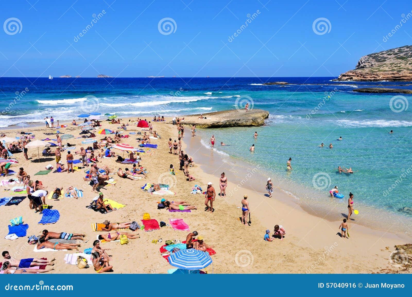 Sunbathers At Cala Conta Beach In San Antonio, Ibiza Island