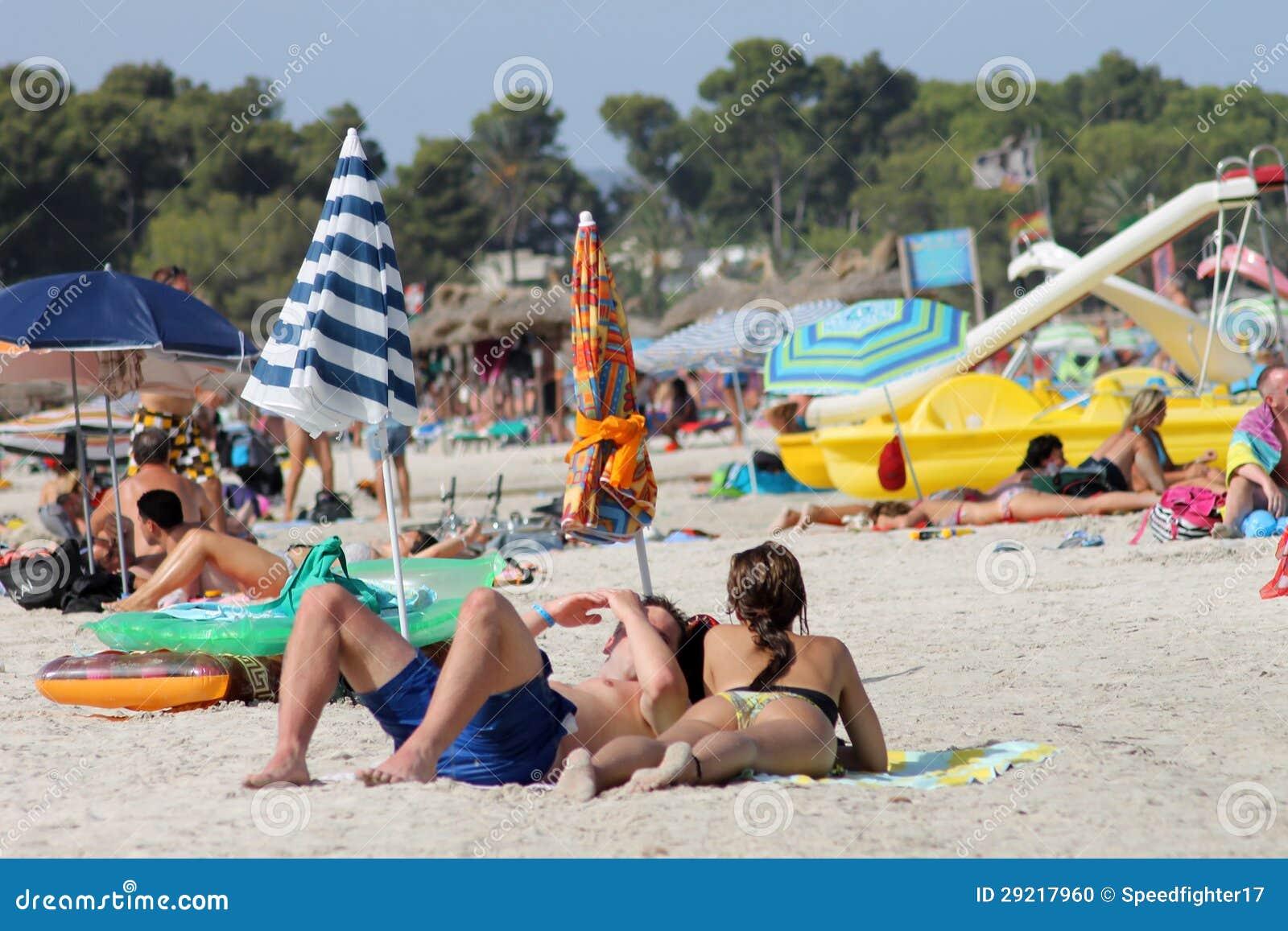 Sunbathers On Spanish Beach