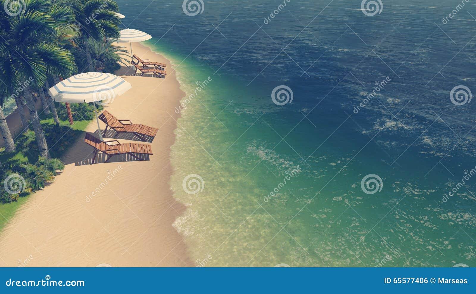 Sunbeds e parasóis na praia tropical