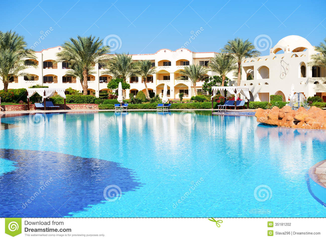 Sunbeds near swimming pool at luxury hotel stock photo for Swimming pool hotel