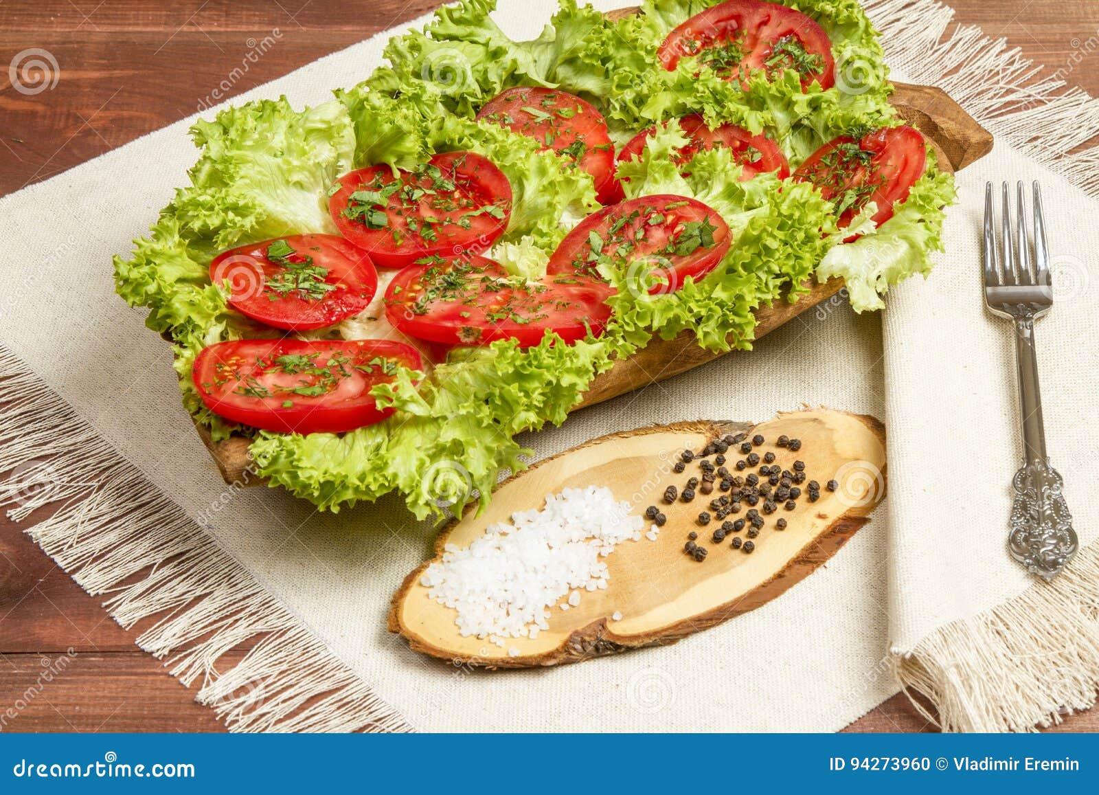 Sunda organiska grönsaker på en träbakgrund