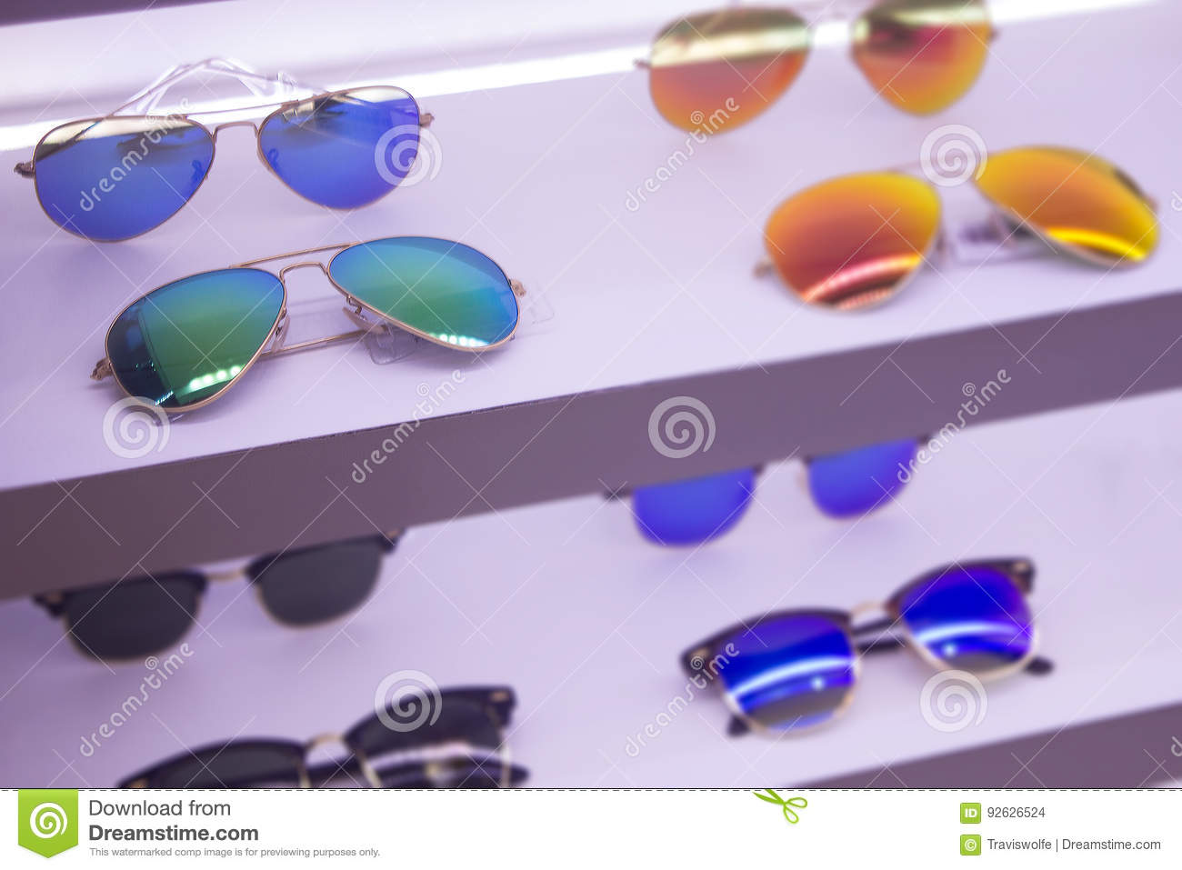 4d08d59a4241 Sunglass shop with sale on high quality lenses on rack. Blue and orange and green  lenses brand name,.