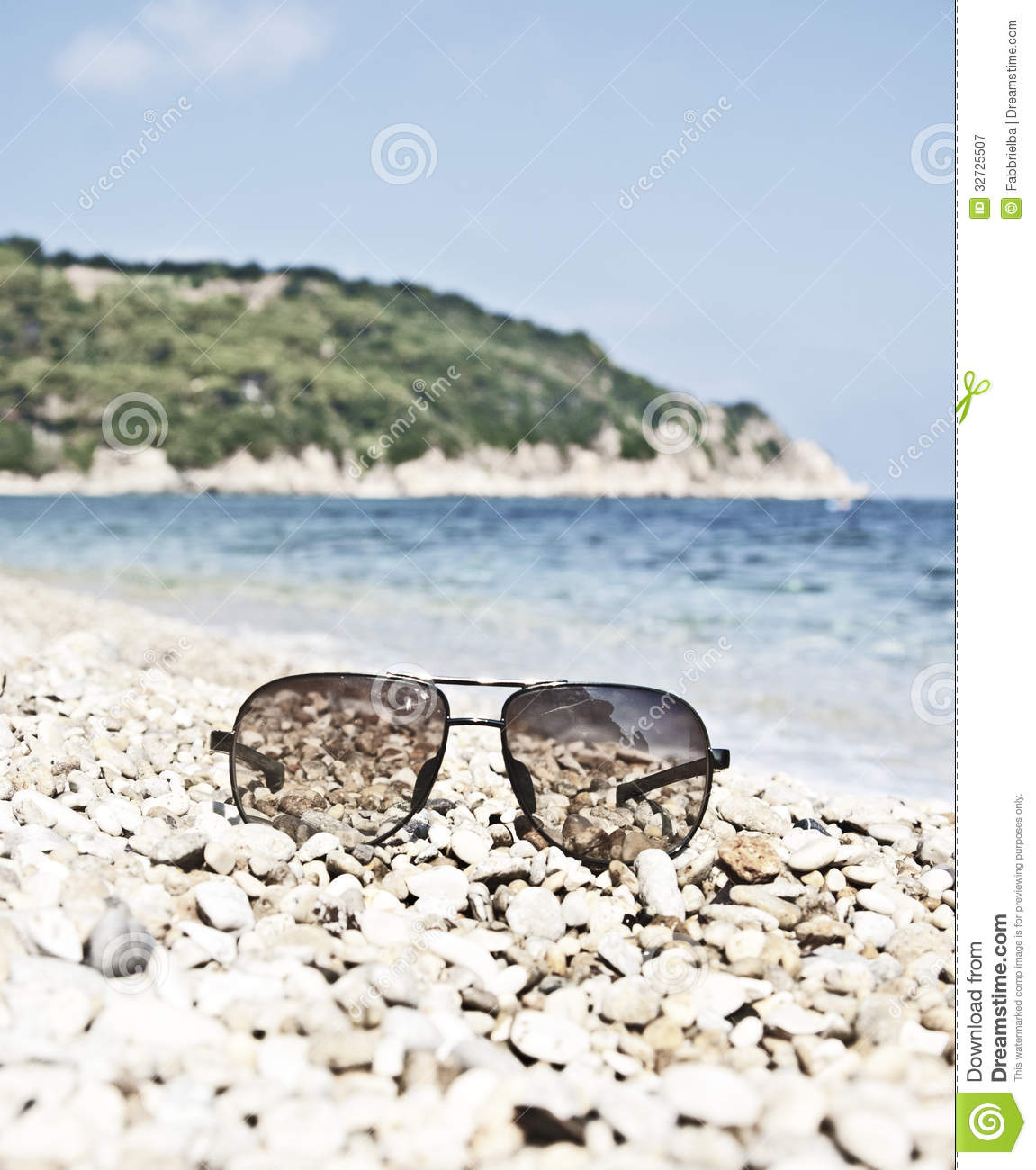 Sunglasses On The Beach Stock Image. Image Of Gadgets
