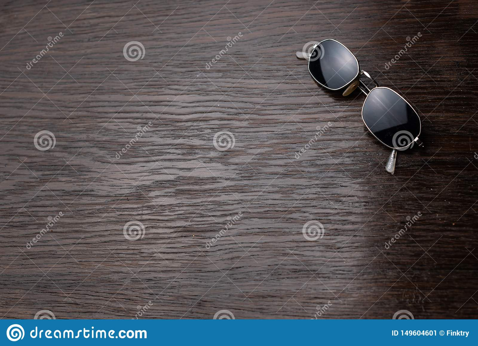 Sunglasses on a dark wooden table