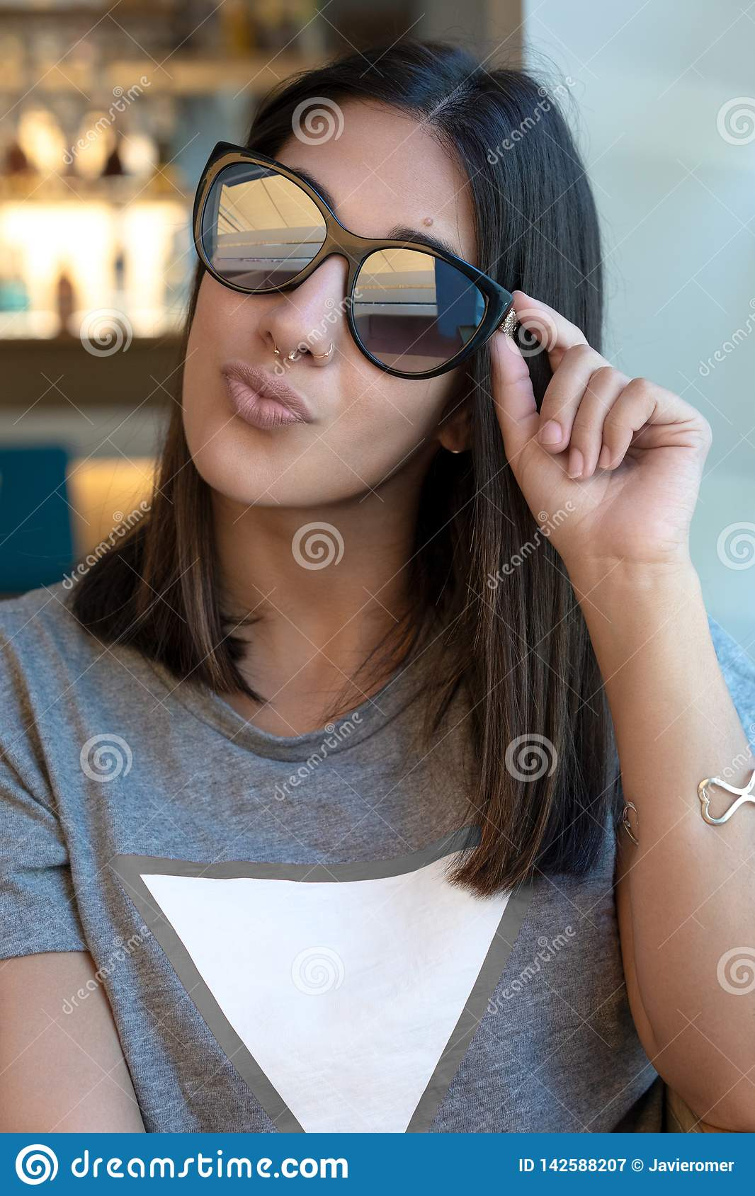 Sunglasses girl kissing at camera