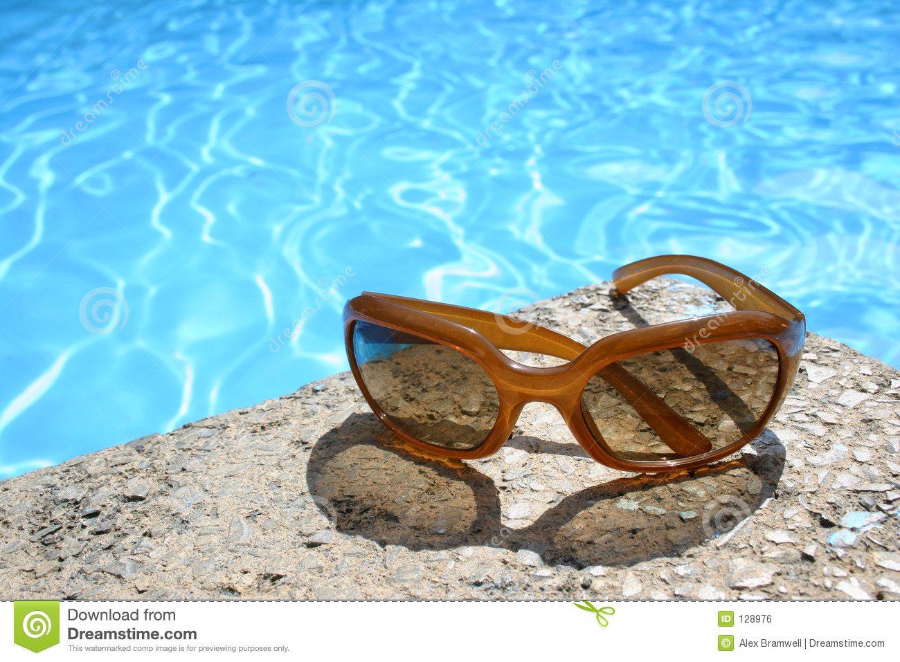 Sunglasses By Pool Royalty Free Stock Image