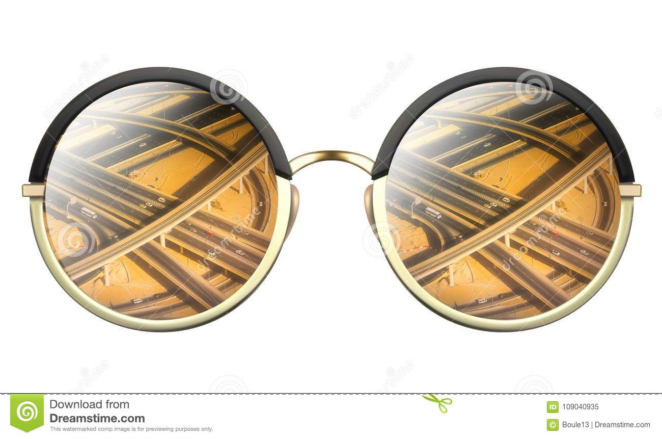 Sunglasses with reflection of road intersection