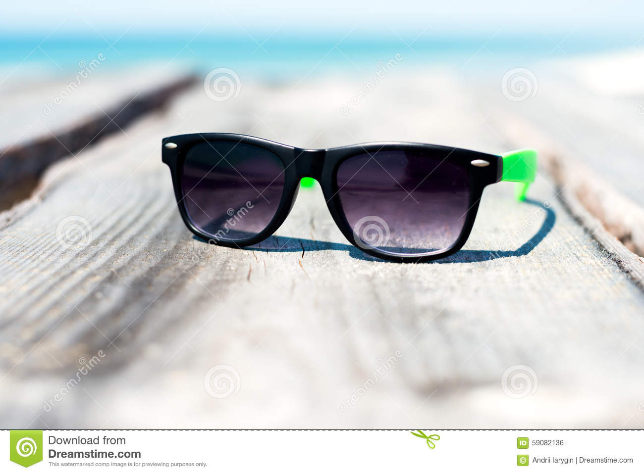 Sunglasses At The Seaside Stock Photo