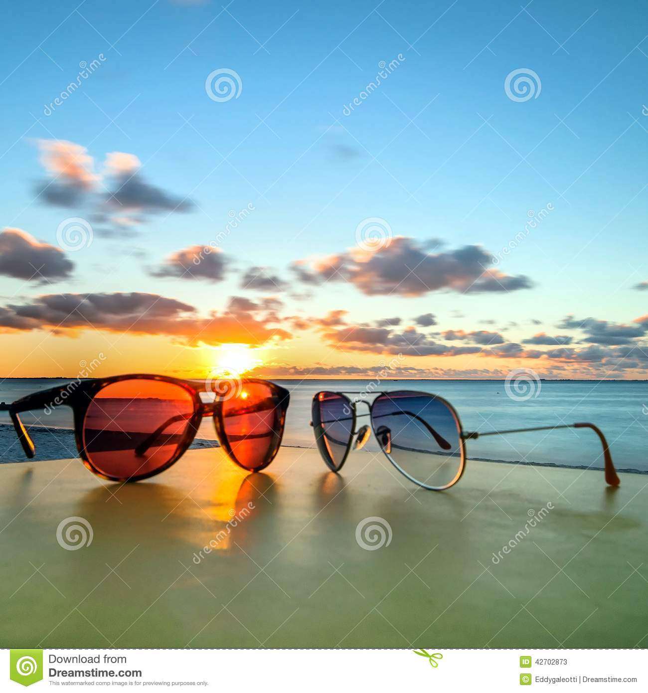 Sunglasses On Tropical Beach Table At Sunset Stock Image