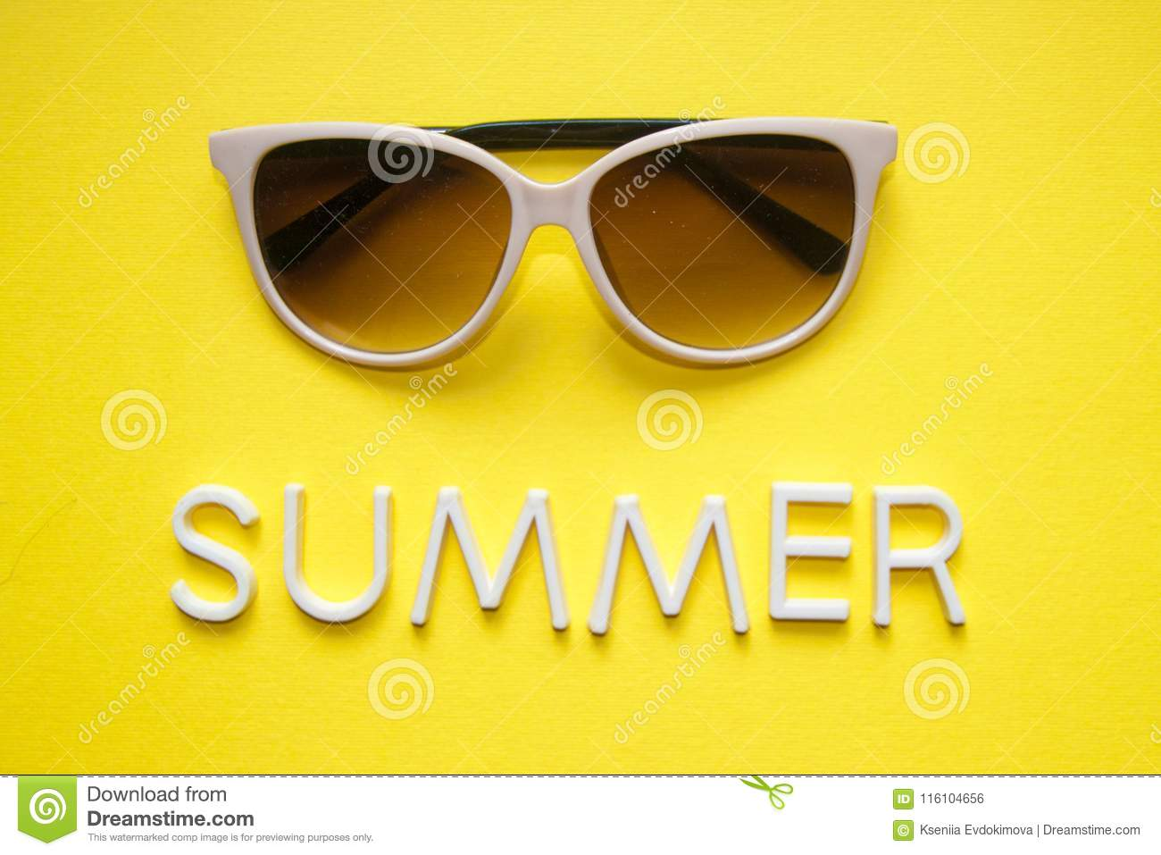 Sunglasses on yellow background and text summer. Top view. Holidays and vacation concept