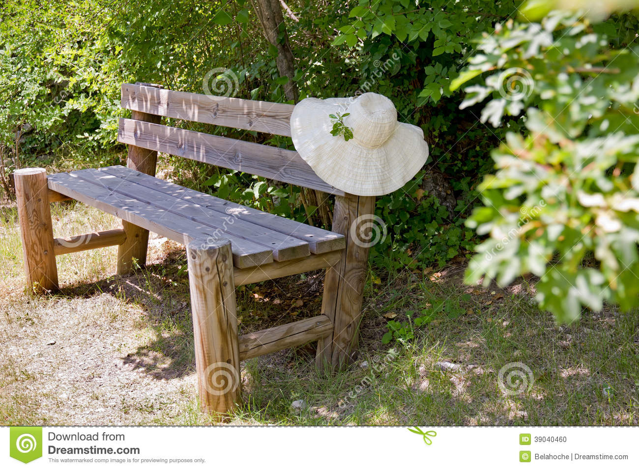 Sunhat On A Wooden Garden Bench. Wide Brimmed Summer Sunhat Draped Over The  Back Of