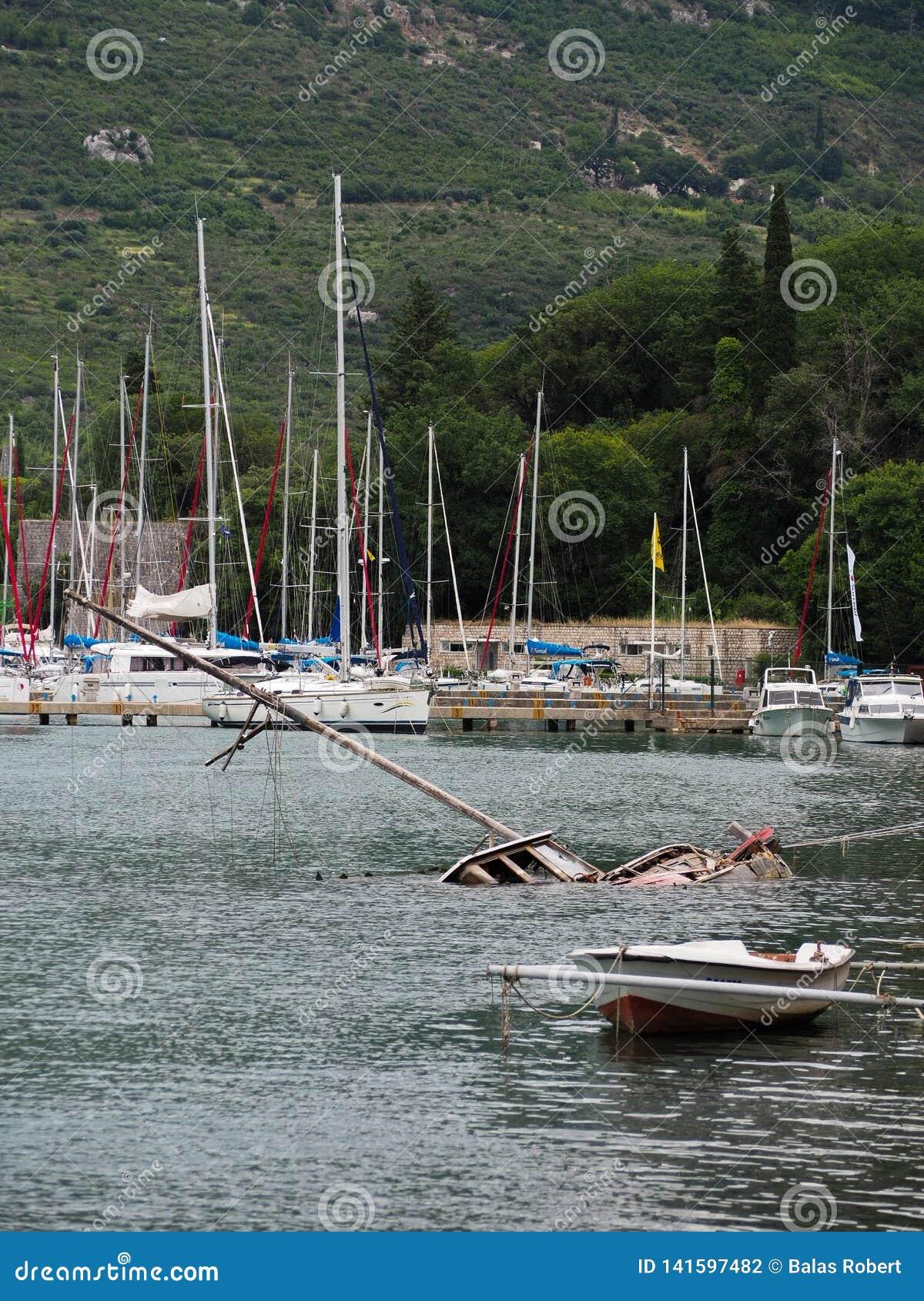Sunk destroyed boat in harbor